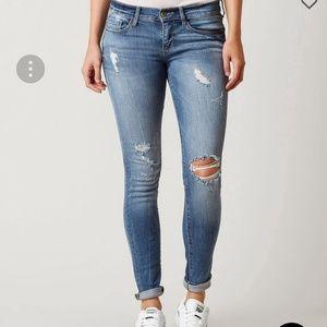 Denim - Disressed skinny ankle jeans
